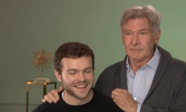 Watch Harrison Ford Surprise Young Han Solo Alden Ehrenreich During ET Interview [Video]